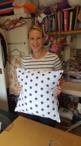 private sewing lesson student Lucy with her first project, a cushion cover