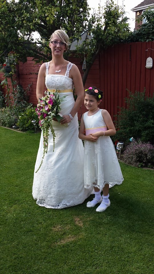 bride amd flower girl in bespoke gowns