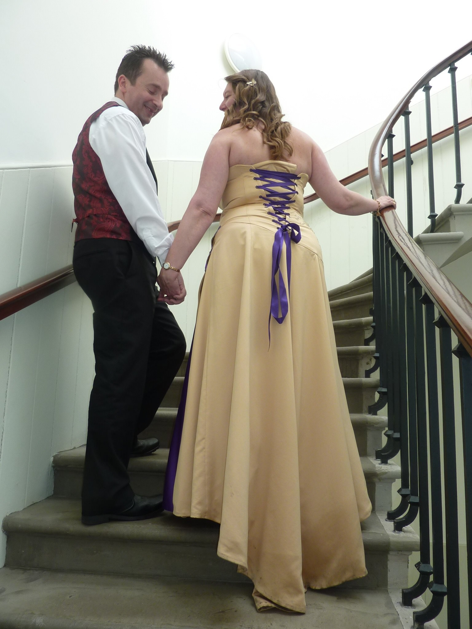 purple corset back on gold wedding gown