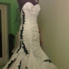 mermaid style ruched white wedding gown