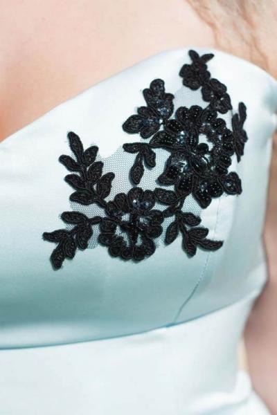 Black lace detailing on pale blue wedding dress