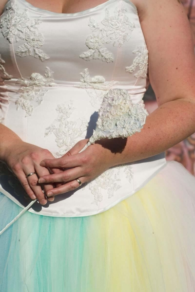 Rainbow tulle skirt with soft pink bustier featuring ivory lace detail