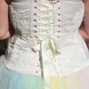 Pale pink corset with lace detailing and rainbow tulle skirt