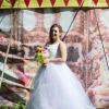 White tulle wedding gown with pastel rainbow layers