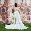 Chiffon Grecian style wedding gown with pastel rainbow underlining