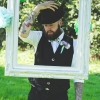 Groom with quirky waistcoat and bowler hat